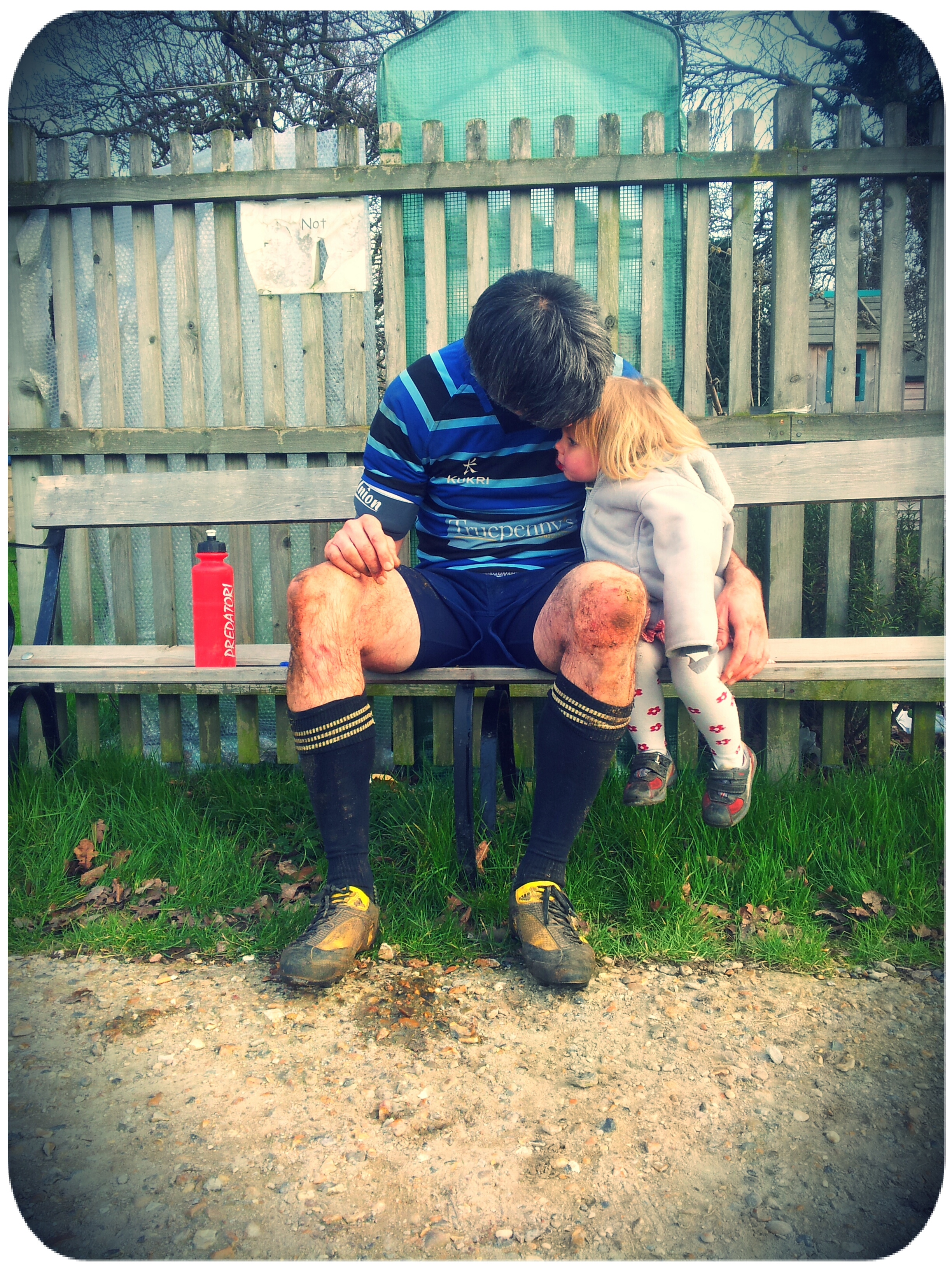 Muddy cuddles for Ramona during Tim's game of rugby